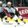 3 Mar 1996:  Defenseman Bill Houlder of the Tampa Bay Lightning moves the puck during a game against the Anaheim Mighty Ducks at Arrowhead Pond in Anaheim, California.  The game was a tie, 2-2. Mandatory Credit: Todd Warshaw  /Allsport