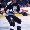 27 Oct 1999: Bill Houlder #2 of the Tampa Bay Lightning stops on the ice during the game against the Buffalo Sabres at the Marine Midland Arena in Buffalo, New York. The Sabres defeated the Lightning 4-3.