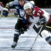 13 Nov 1998:  Defenseman Cory Cross #4 of the Tampa Bay Lightning in action against center Chris Drury #37 of the Colorado Avalanche during the game at the McNichols Arena in Denver, Colorado. The Avalanche defeated the Lightning 8-1. Mandatory Credit: Brian Bahr  /Allsport