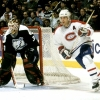 Canadiens forward Shayne Corson #27 and Lightning goaltender Rick Tabaracci #31 ina game at the Molson Centre during the 1996-97 season (Photo by Denis Brodeur/NHLI via Getty Images)