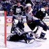 2000 Season: Tampa goaltender Rick Tabaracci is busy making the kick save and tripping up New York Islander Todd Bertuzzi at the same time.  (Photo by Jim McIsaac/Getty Images)