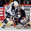 UNIONDALE, NY - JANUARY 2:  Rob DiMaio #18 of the Tampa Bay Lightning tries to deflect the puck past goaltender Garth Snow #30 of the New York Islanders  during their game on January 2, 2005 at Nassau Coliseum in Uniondale, New York.  (Photo by Jim McIsaac/Getty Images)